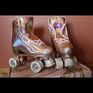 Impala Rose Gold quad skates size 7